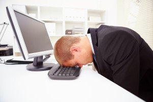 bigstock_A_Tired_Businessman_With_His_F_5758089